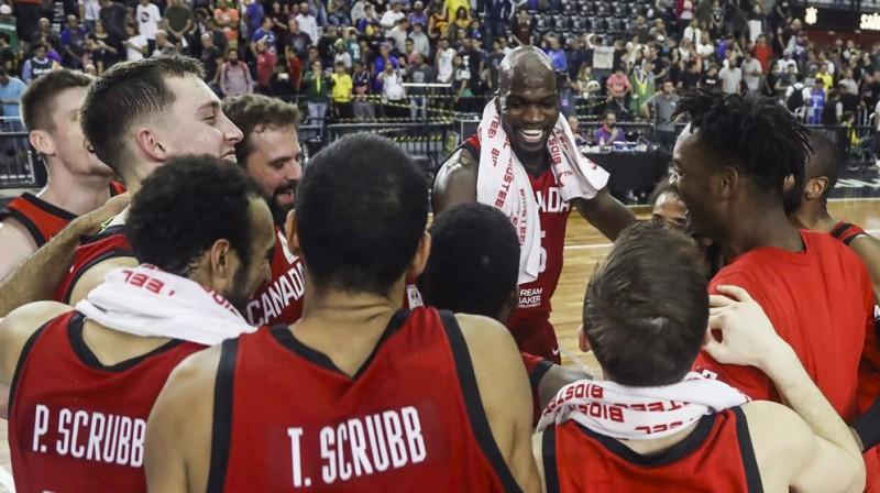 Kanāda līksmo par iegūto ceļazīmi uz Pasaules kausu. Foto: FIBA
