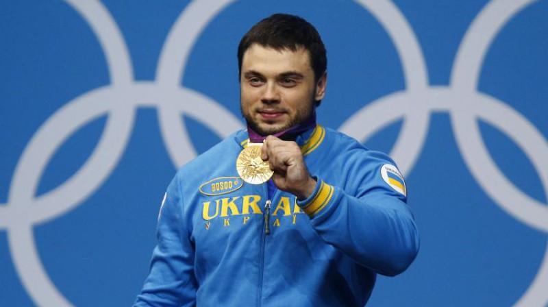 Oleksijs Torohtijs svin Londonas OS zelta medaļu 2012. gadā. Foto: Reuters/Scanpix