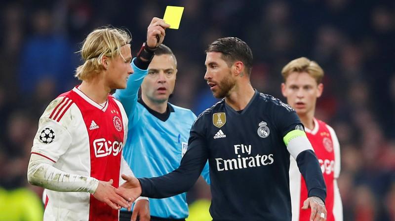 Serhio Ramoss un Kaspers Dolbergs. Foto: Reuters/Scanpix