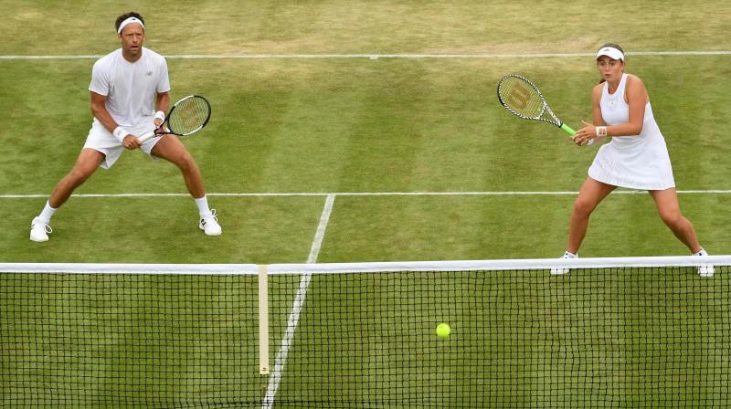 Roberts Lindsteds un Aļona Ostapenko. Foto: AFP/Scanpix