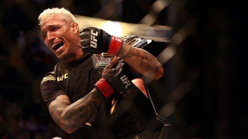 Čārlzs Oliveira ar UFC čempiona jostu. Foto: USA Today Sports/Scanpix